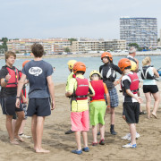 Students learning to sail at the main beach in L'Escala
