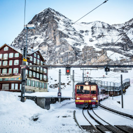 The Jungfraujoch train comes into Kleine Scheidegg on a cold winter morning beneath the Eiger Nordwand, Switzerland