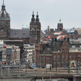 Amsterdam cityscape: Central railway station, Basilica of St. Nicholas. Amsterdam, Netherlands, Northern Europe.